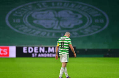 Scott Brown walks off the pitch at Celtic Park