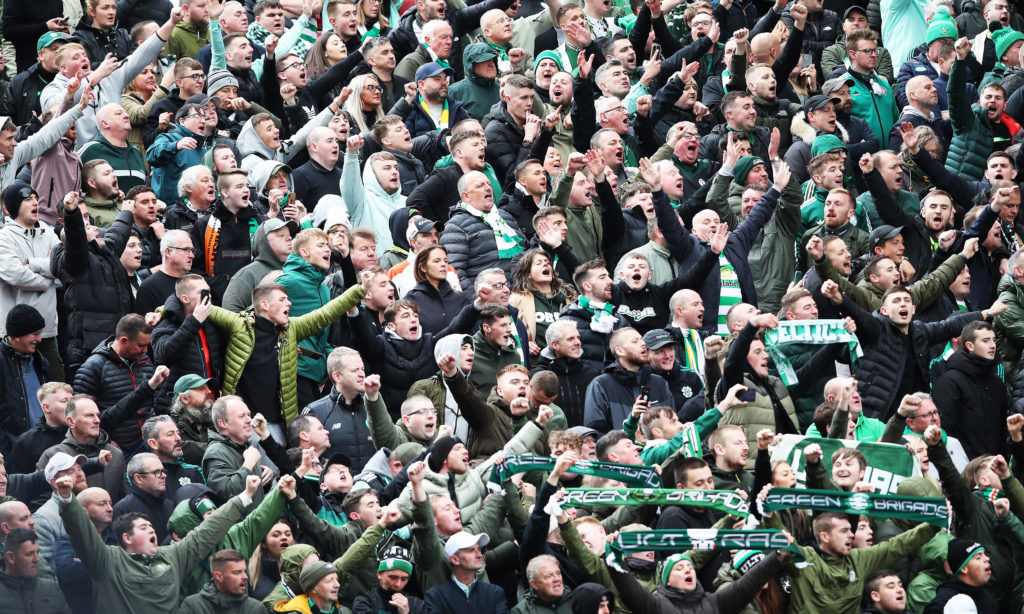 The Celtic fans celebrate at Pittodrie